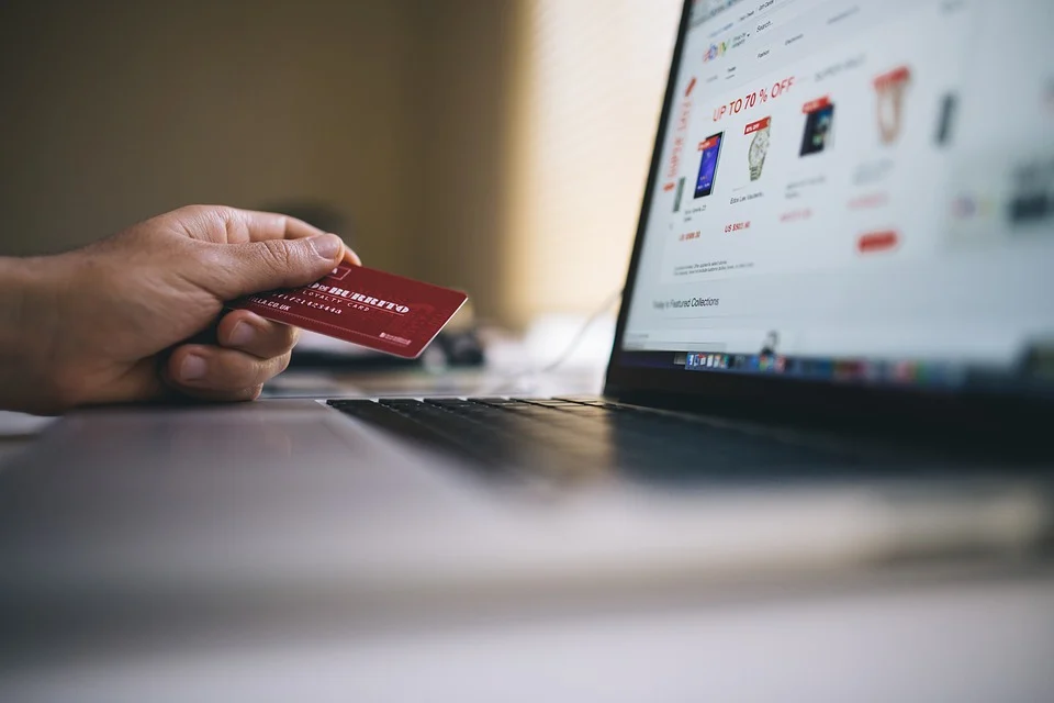 A person shopping on an e-commerce website with a credit card