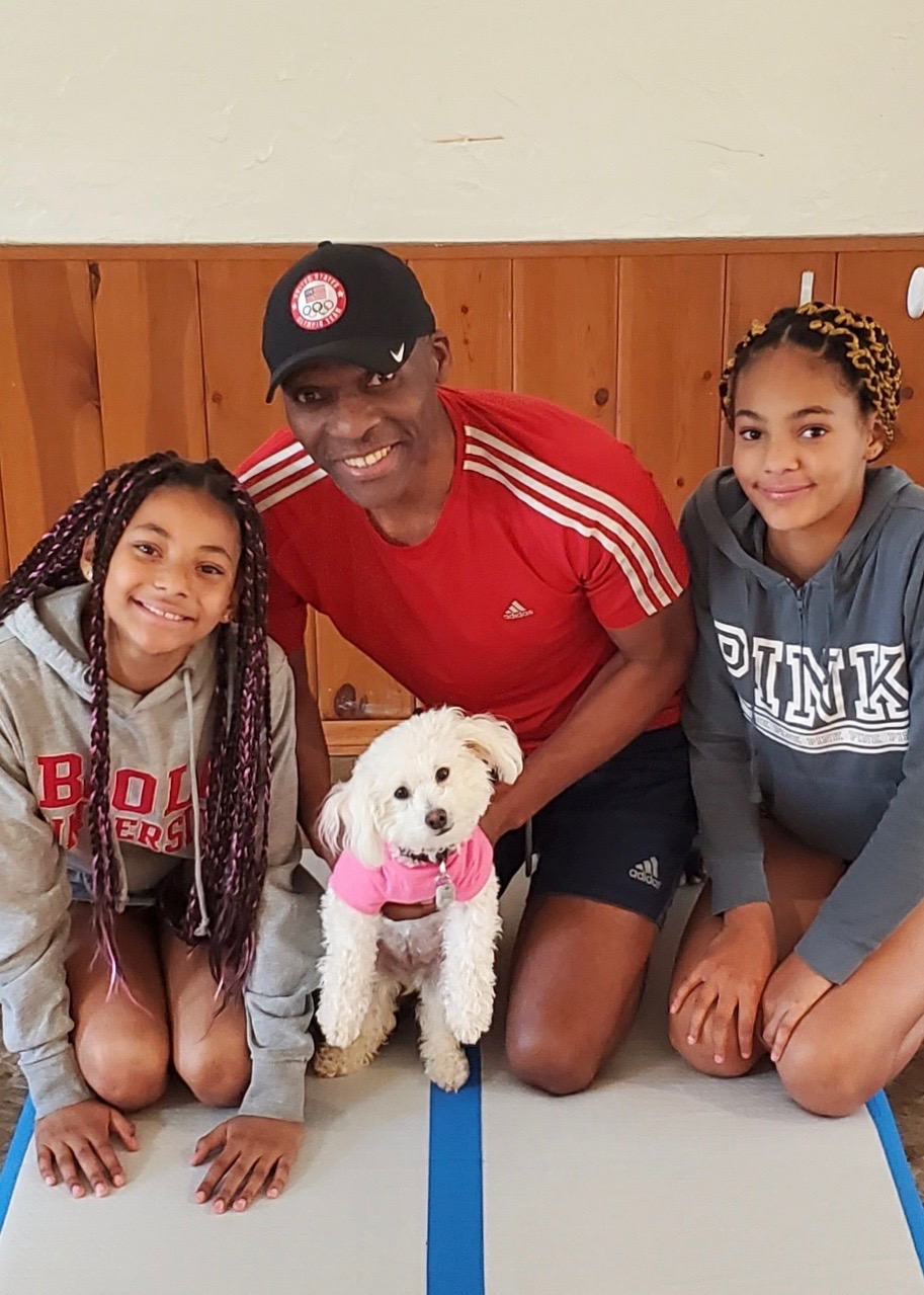 Chief O and his daughters with their little dog