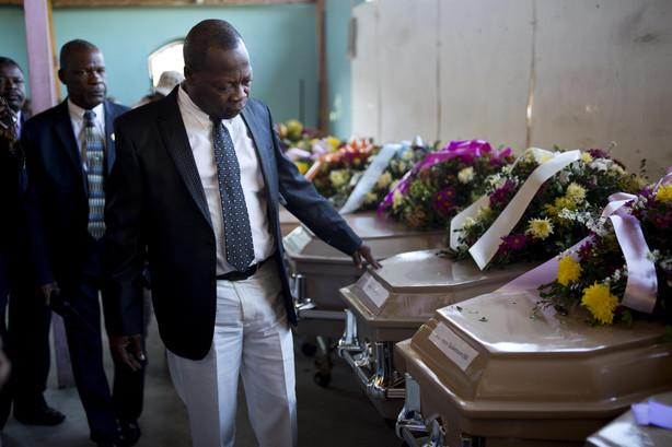 Image result for students with casket demonstration haiti photos