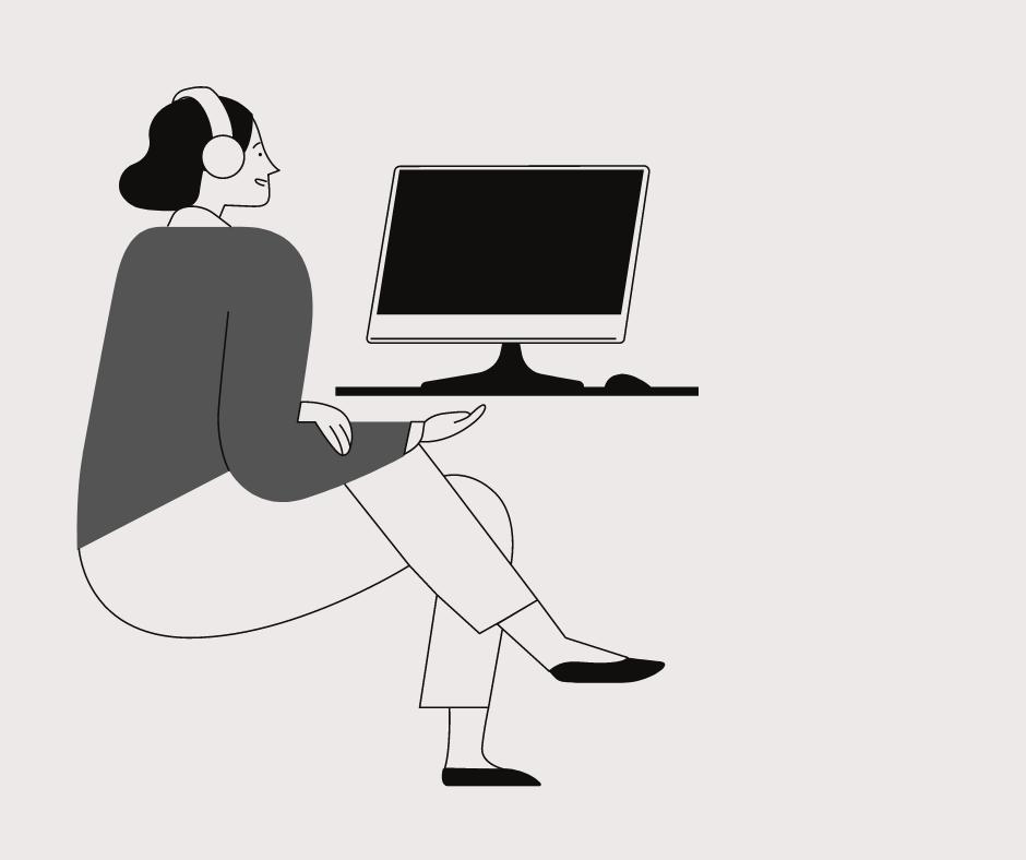Seated woman looking at a computer monitor.