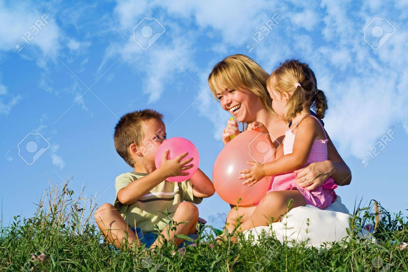 http://previews.123rf.com/images/ilona75/ilona750808/ilona75080800014/3479446-Woman-playing-with-her-kids-and-balloons-in-the-grass-outdoors-against-blue-summer-sky-Stock-Photo.jpg