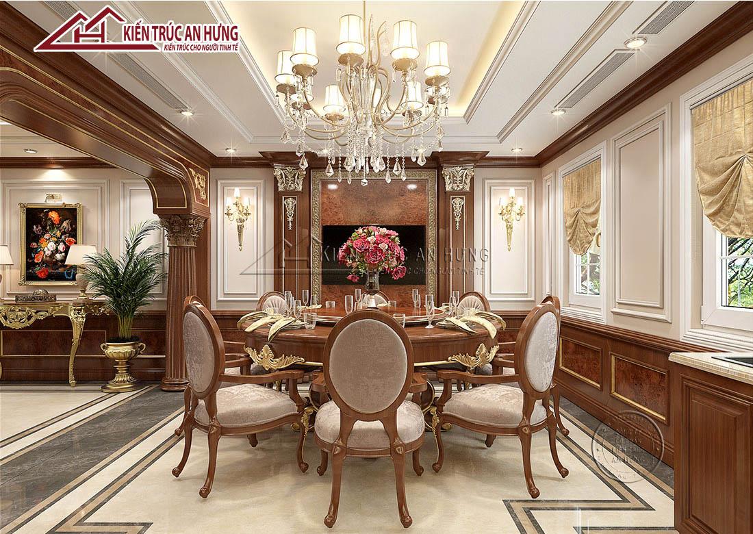 Thiết kế phòng ăn ốp gỗ tông màu nâu trầm sang trọng. Bộ bàn ăn tân cổ đặc trưng mang dạng tròn, được thiết kế từ gỗ cao cấp mang đến vẻ đẹp hoàn mỹ cho cả căn phòng.