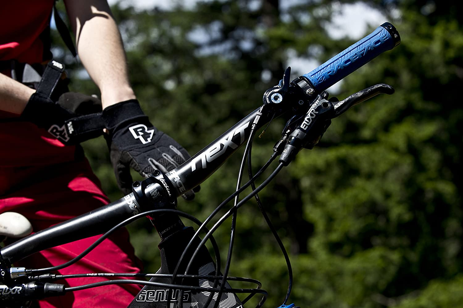 To shorten mountain bike grips, cut them or slide brakes and shifters inwards.