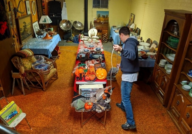 Man setting up an estate sale