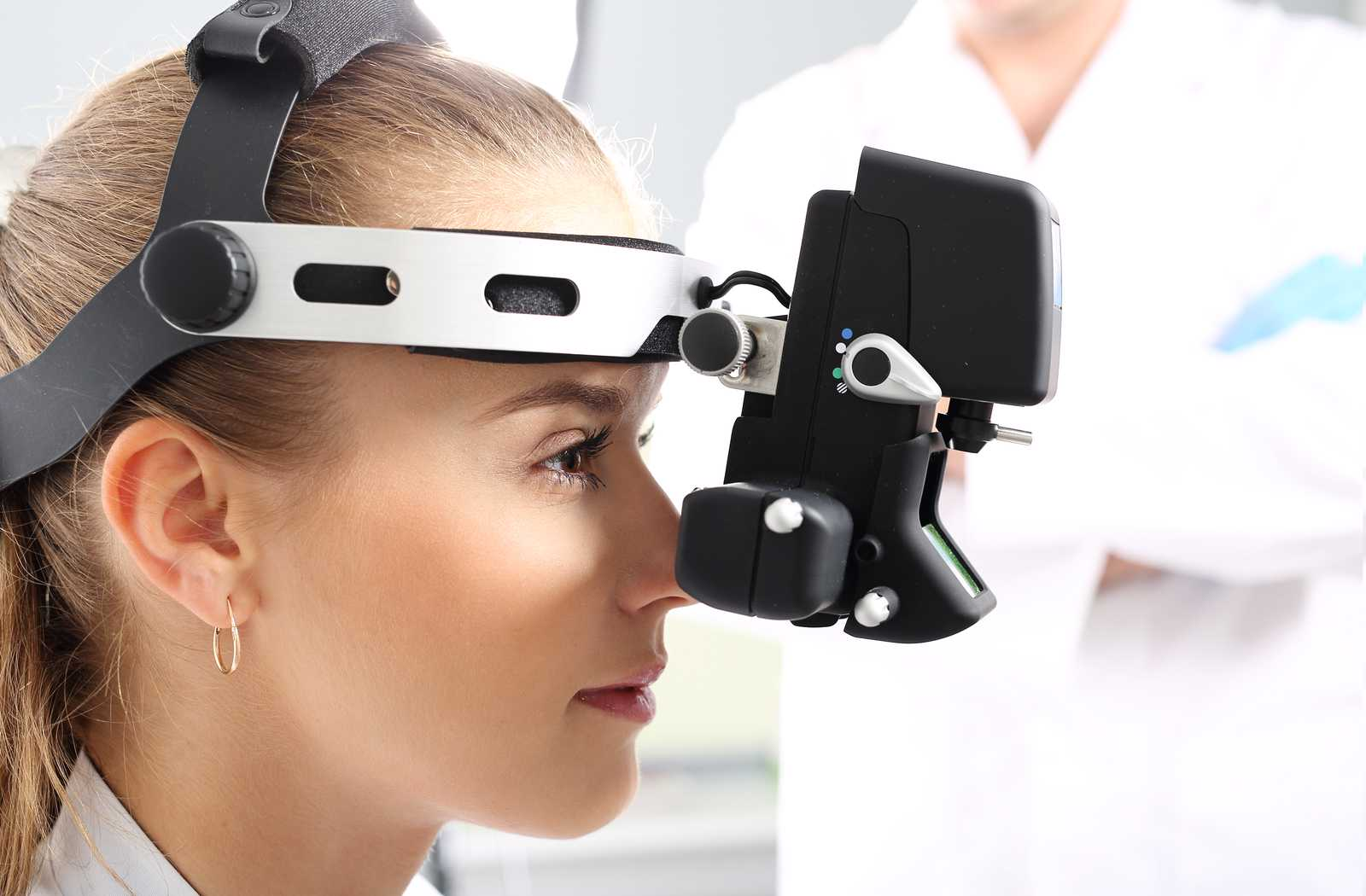 young diabetic woman getting eye health thoroughly checked by ophtalmoscopy