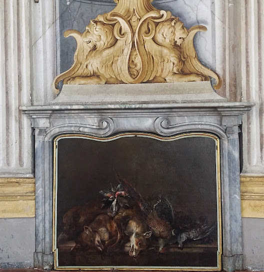 Painting of wild animals that have been hunted lying in the fireplace.