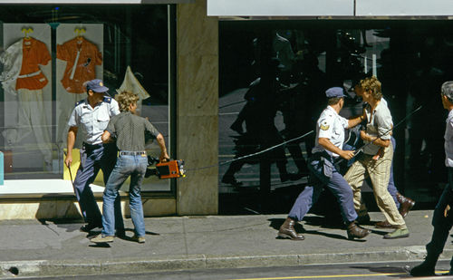 Cameraman Craig Matthews and his soundman, who were filming anti-apartheid protests in Cape Town, are arrested by police with orders to prevent media coverage of the unrest, October 1985, Cape Town, South Africa.