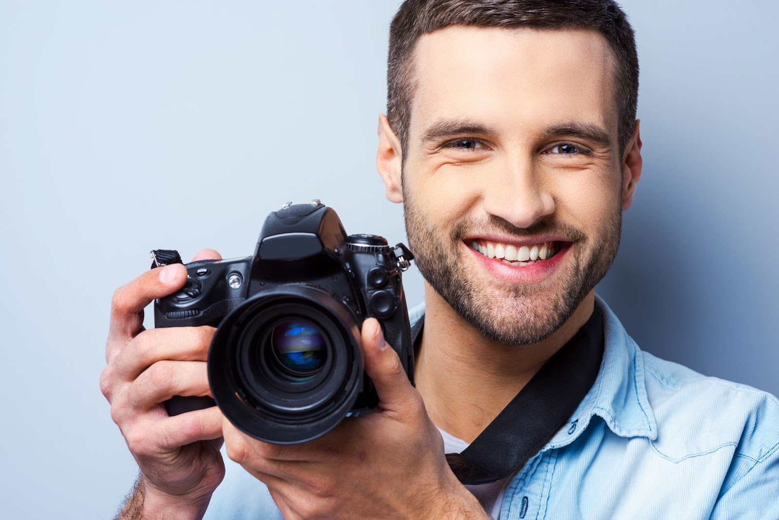 Smiling man with camera