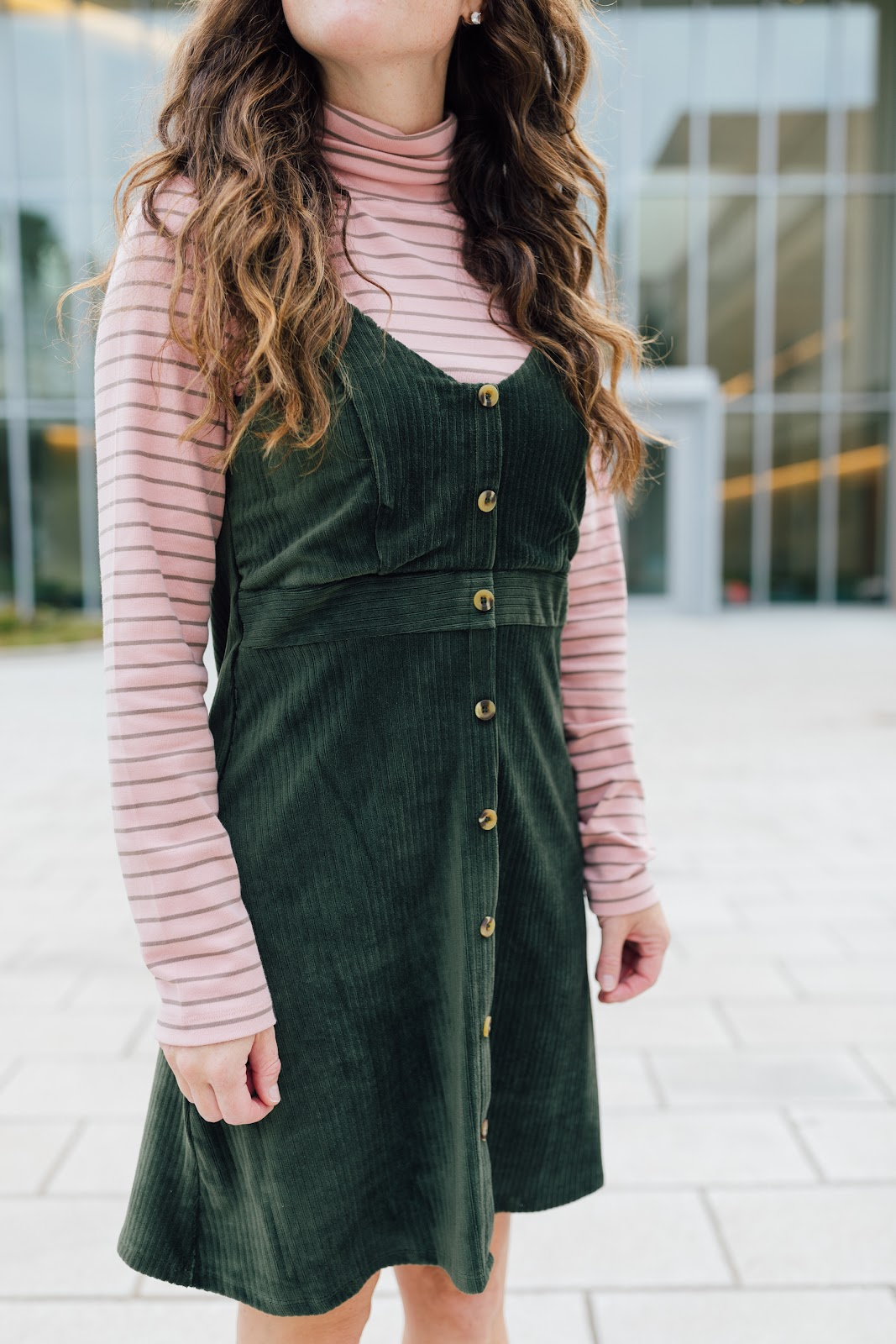 Fall outfit with green jumper and turtleneck and brown suede boots on Caitlin Houston