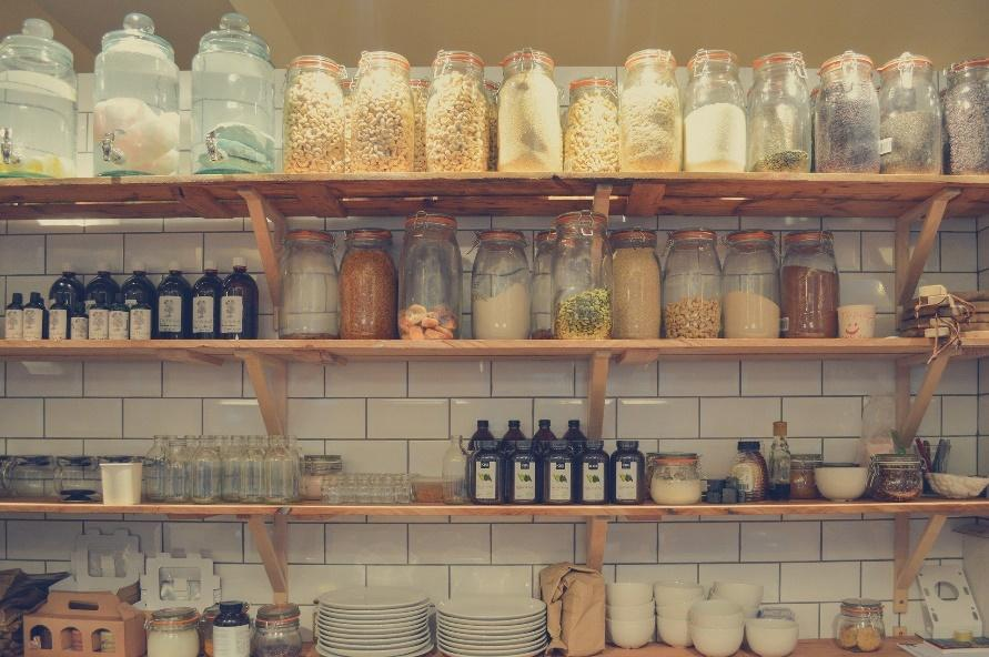 Shelves with organized jars, plates, and bowls.