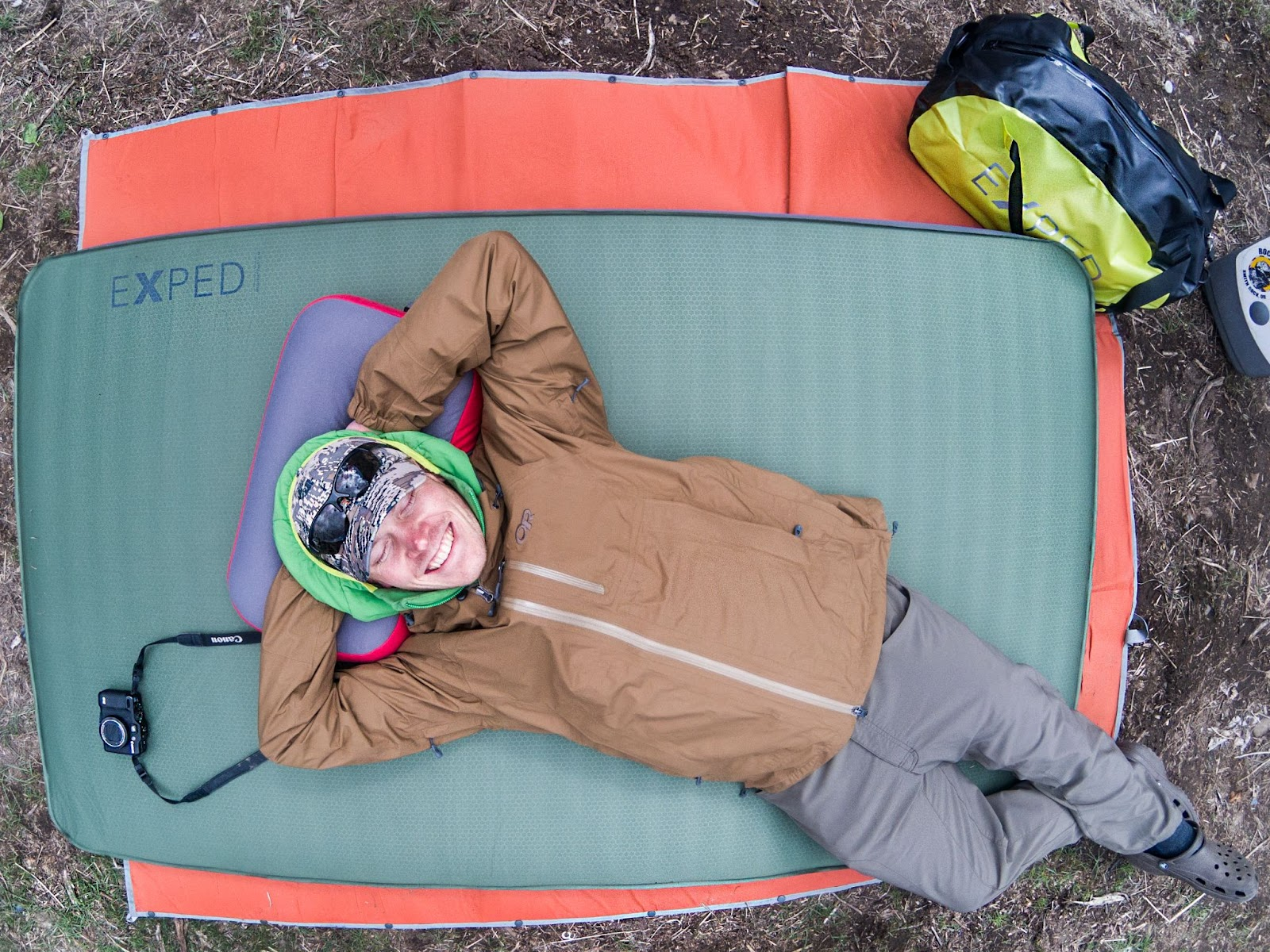 Camper laying down on the Exped Megamat Duo 10