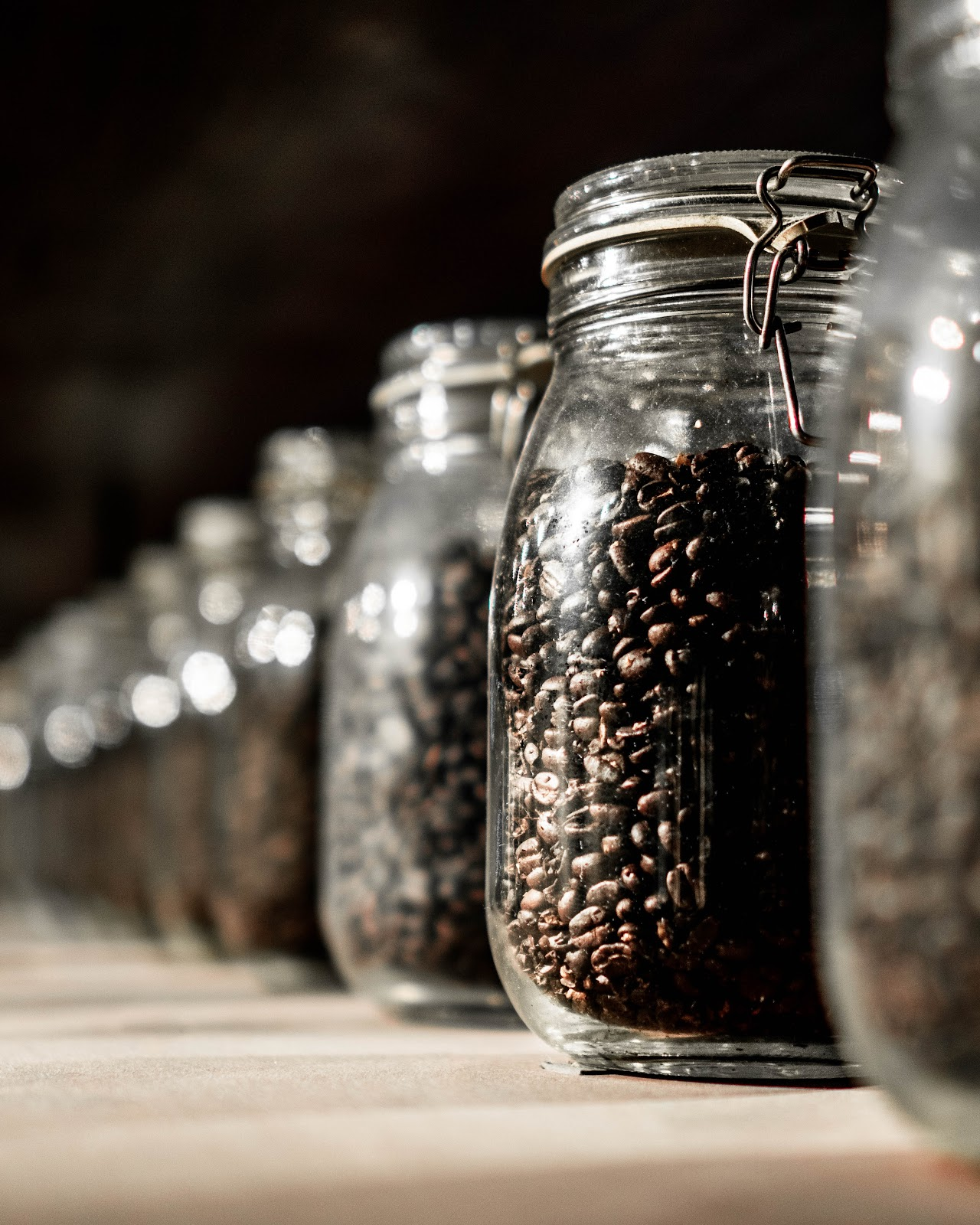 Jars of roasted coffee beans
