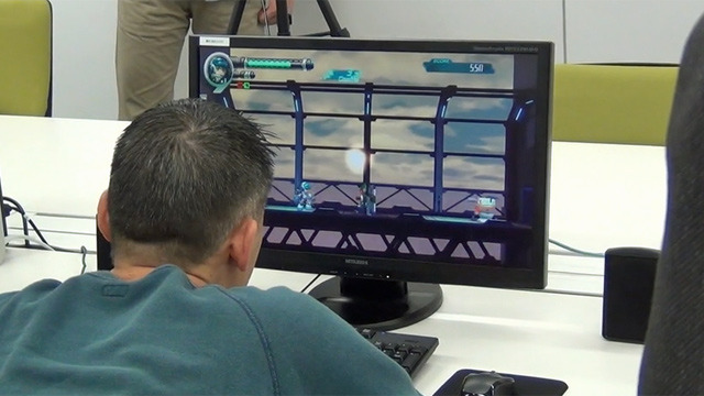 Eyes glued to the screen, Inafune gives a thorough once-over to Beck's movements, enemy animations, the background lighting, so on and so on.