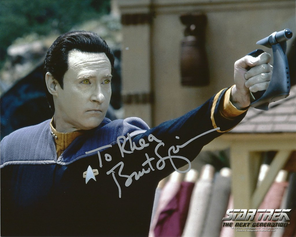 Data from star trek posing with a blaster