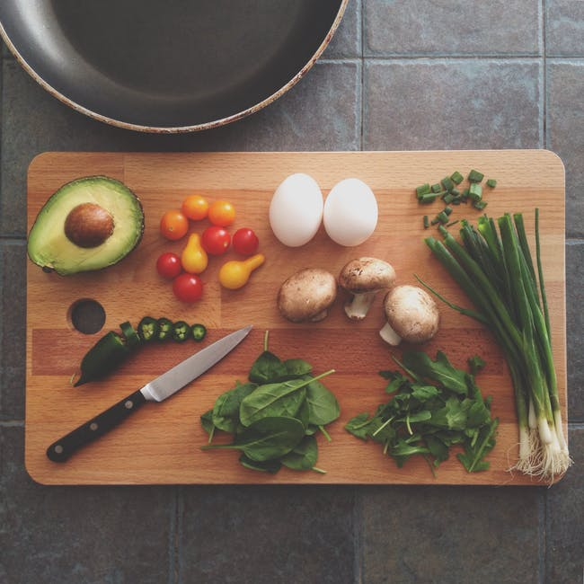 Eggs Avocado Mushroom Basil and Onion Springs on Wooden Chopping Board