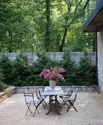 Gravel Patio. French style gravel patio with stone garden walls. Gravel  patio… | Gravel patio, Pea gravel patio, Backyard patio