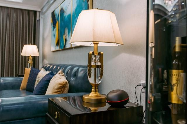 Two lamps next to a leather couch