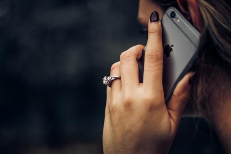 A hand holding a cellphone  Description automatically generated