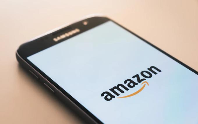 A photo of a smartphone showcasing an Amazon logo