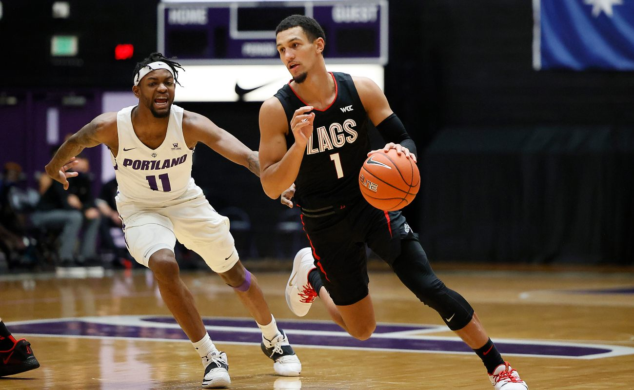 Jalen Suggs #1 of the Gonzaga Bulldogs dribbles the ball as Latrell Jones #11 of the Portland Pilots defends during the first half at Chiles Center on January 09, 2021, in Portland, Oregon.