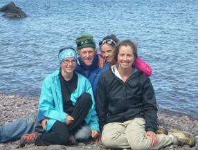 A group of people sitting posing for the camera  Description automatically generated