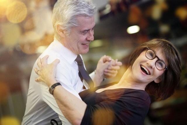 senior couple dancing together at dance hall