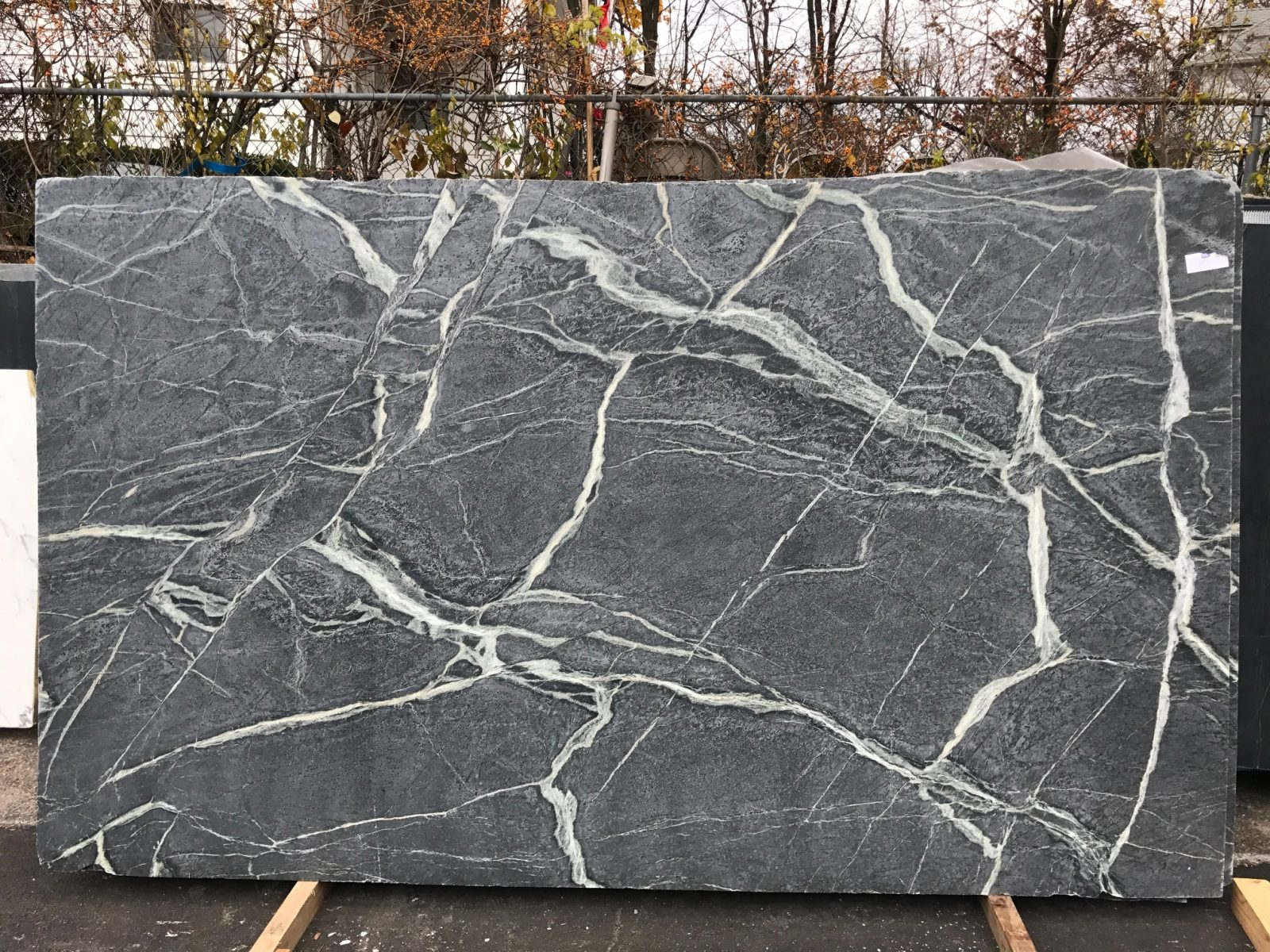 slab of black soapstone with white veins outside