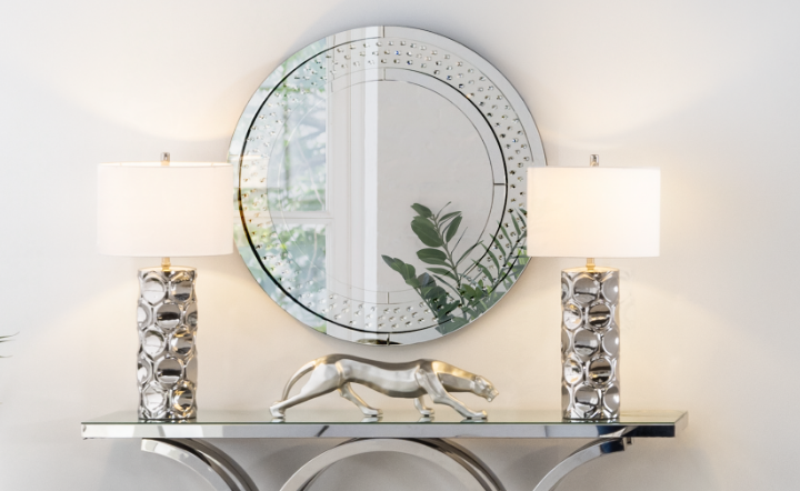 Mirrors and two light lamps, on top of a console. Jaguar decor item.