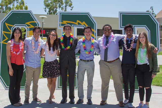A few of the members of the 2017-18 ASI Student Government administration posing for a photo in front of large CPP letters.