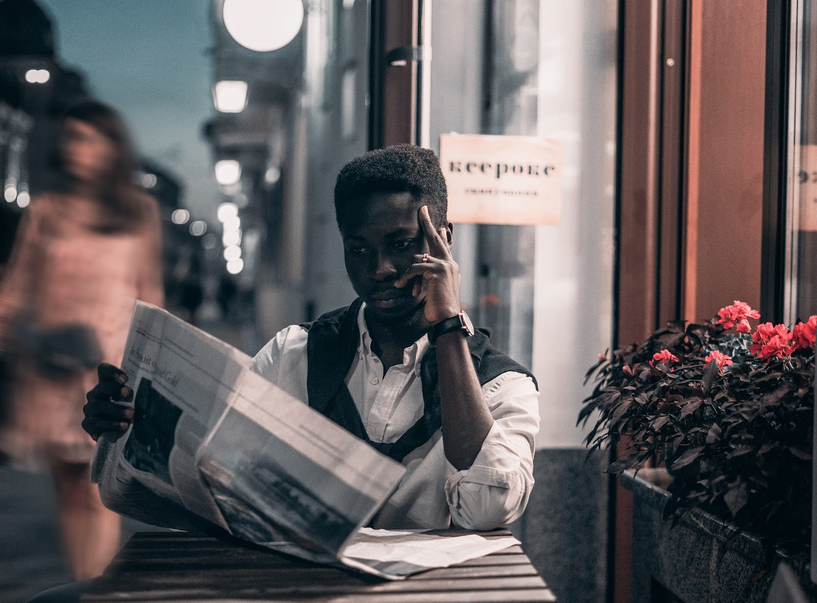 Man immersed in reading a newspaper.