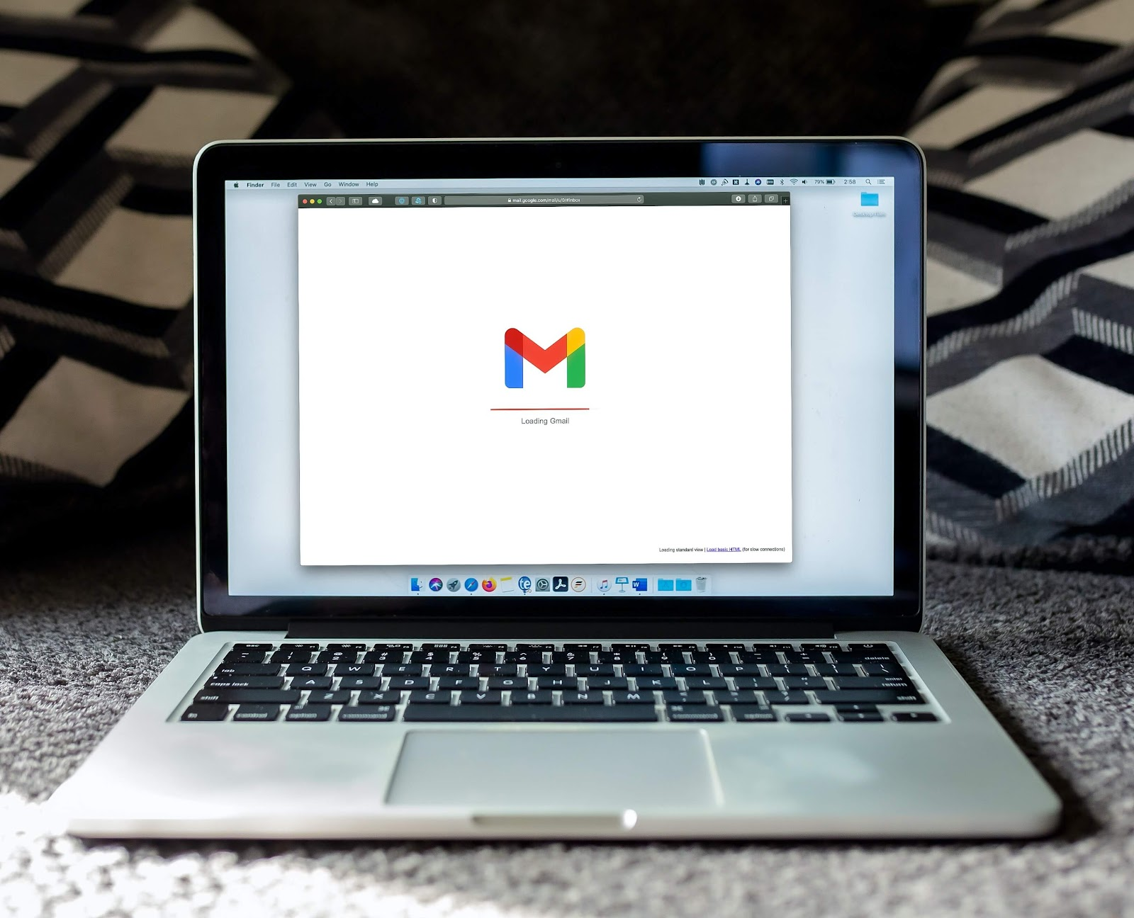 Gmail opening on laptop to view charity emails