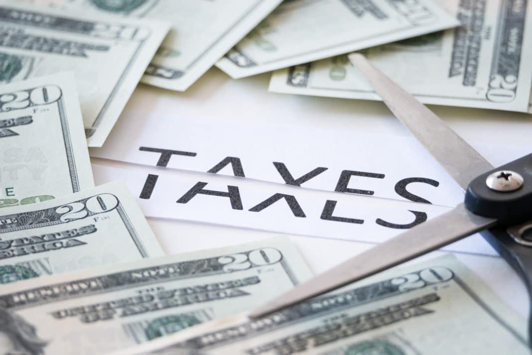 https://centrefordevelopmentgreatlakes.org/wp-content/uploads/2019/12/pay-less-taxes-save-money-1068x713.jpg