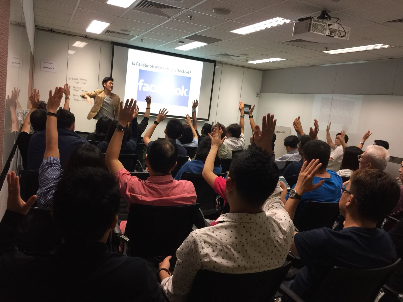 Alaric Ong with audience raising hands