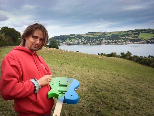 Muse frontman Matt Bellamy paints a sheep guitar near his home in Teignmouth
