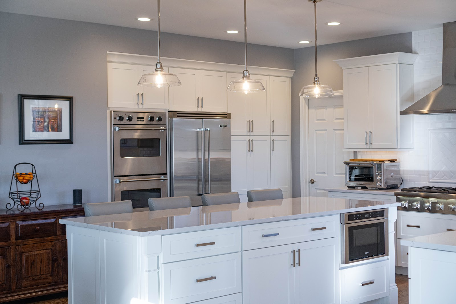 HDC Kitchen with White cabinets and marble counter top