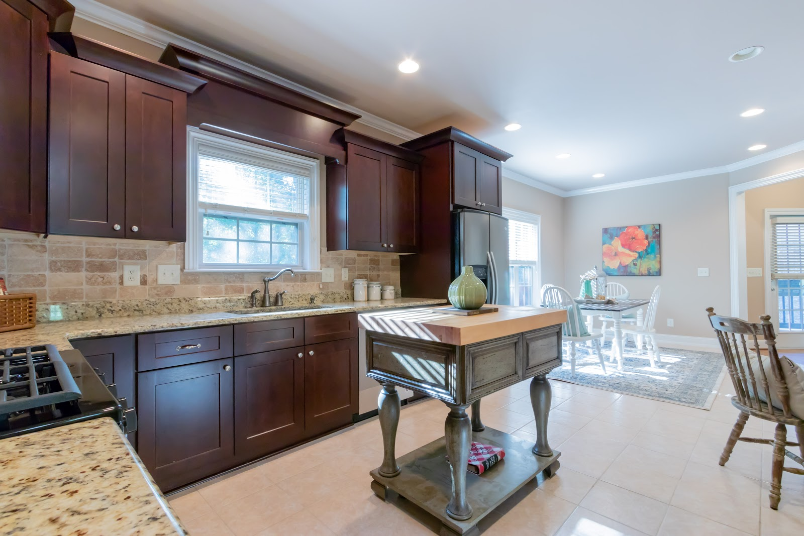 Define spaces with rugs is another part of how to stage your kitchen