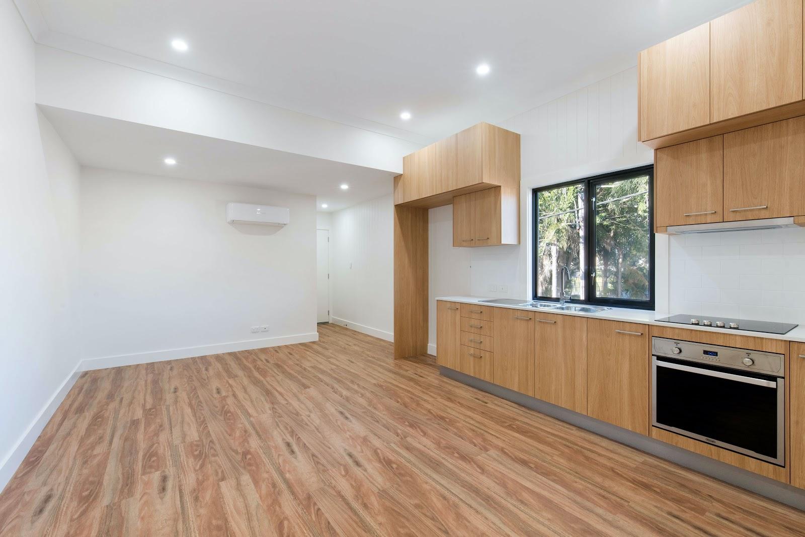 Empty kitchen with wood floors
