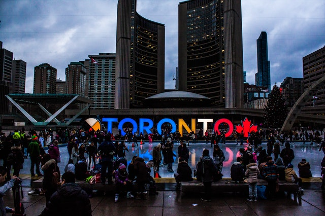crowd in front of toronto sign