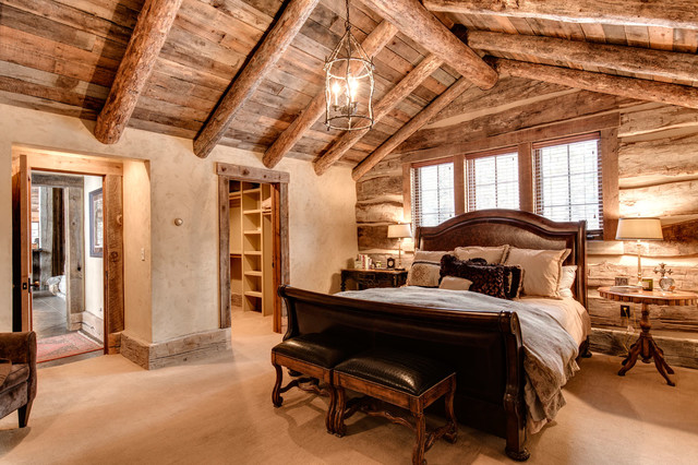 natural wood bedroom with leather bed and sitting chairs