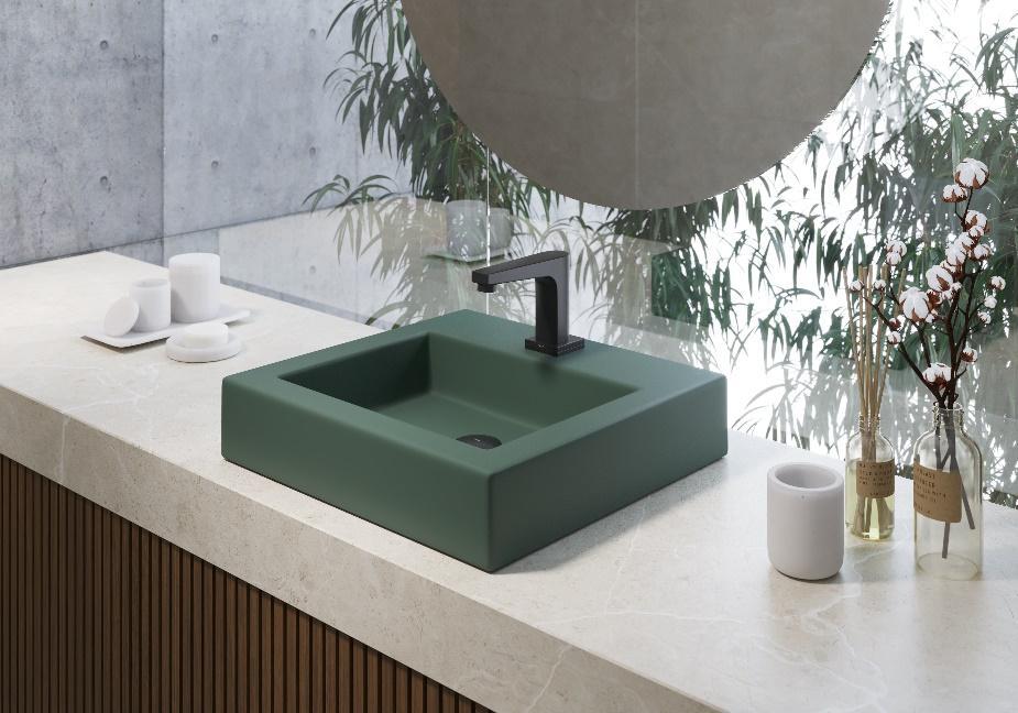 bancada de porcelanato marmorizado branco com cuba verde e torneira preta.