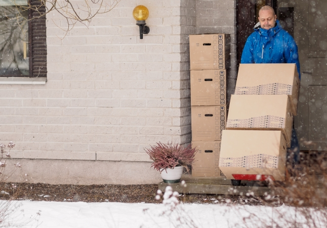 A man moving in the snow, earlier in the year than is typical.