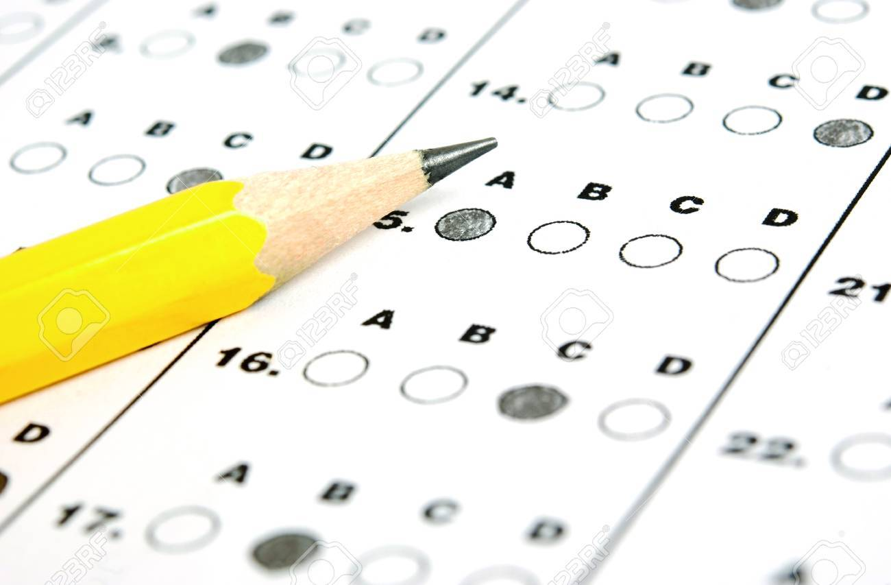 A Pencil Sitting On A Test Bubble Sheet Stock Photo, Picture And Royalty  Free Image. Image 74092651.