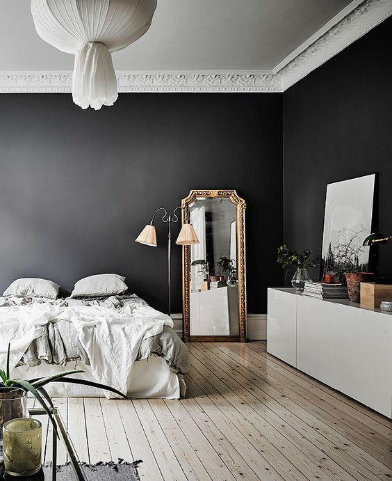 Add a gold mirror in bedroom