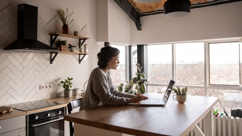 woman checking her building's rules for moving in and out on her laptop
