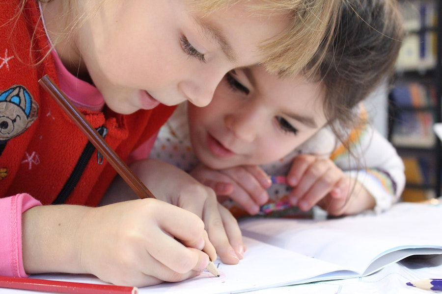 Young children doing a worksheet