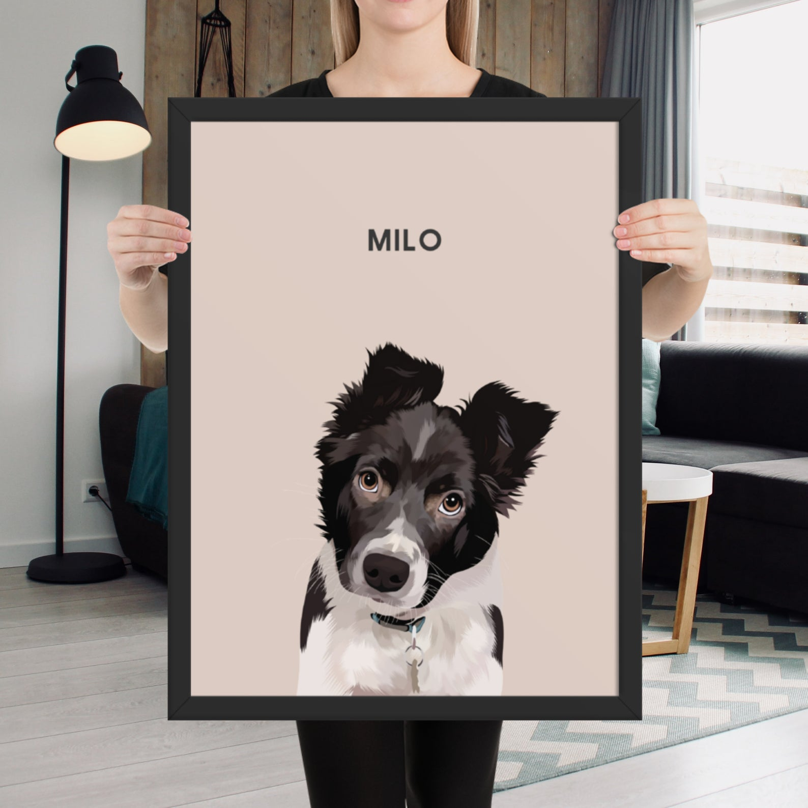 Person holding a dusty pink framed dog portrait with a Border Collie puppy named Milo