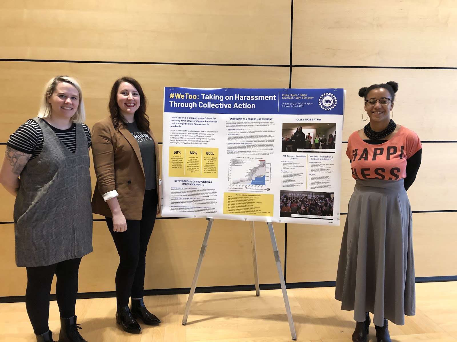 UAW members presenting a poster on the role of unionization in addressing sexual harassment in academia