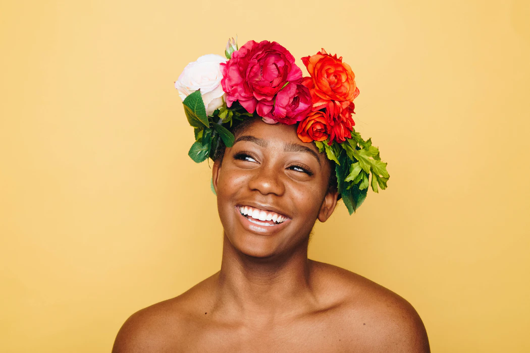 woman with colorful flower hat