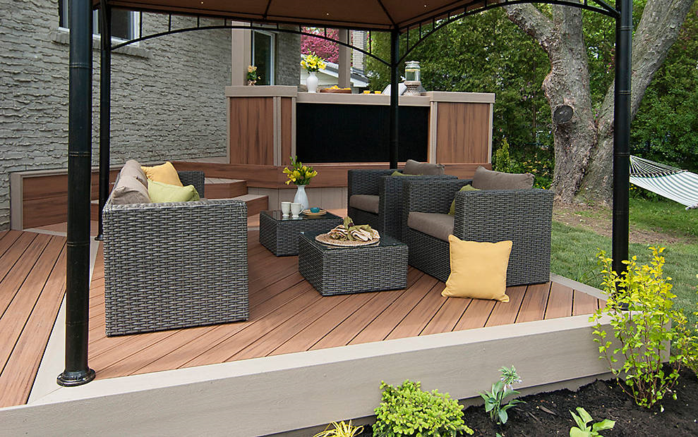 outdoor covered patio with matching couches and ottomans