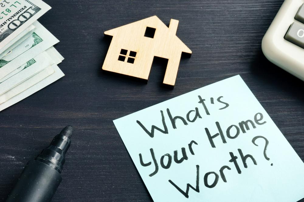 "Note asking the question, ""What's Your Home Worth?"""